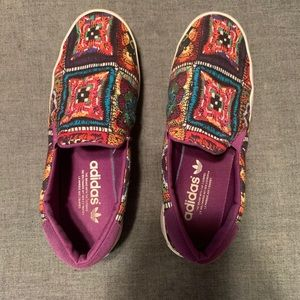 Psychedelic Adidas slip-on shoes